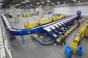 椿本チエインと協栄産業、テキスタイル物流の新センターでロボットとソーター連携し大幅省人化・省力化へ